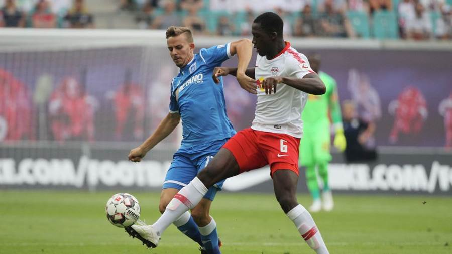 LEIPZIG, GERMANY - AUGUST 09: Ibrahima Konate of Leipzig challenges Nicusor Bancu of Craiova during the UEFA Europa League Third Qualifying Round: 1st leg between RB Leipzig and Universitatea Craiova at Red Bull Arena on August 09, 2018 in Leipzig, Germany. (Photo by Karina Hessland-Wissel/Bongarts/Getty Images)