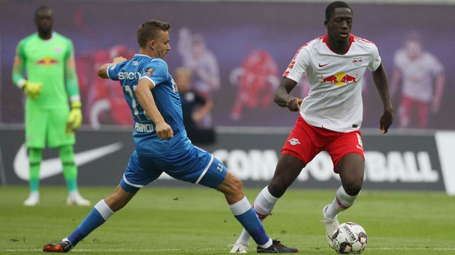 LEIPZIG, GERMANY - AUGUST 09: Ibrahima Konate of Leipzig is challenged by Nicusor Bancu of Craiova during the UEFA Europa League Third Qualifying Round: 1st leg between RB Leipzig and Universitatea Craiova at Red Bull Arena on August 09, 2018 in Leipzig, Germany. (Photo by Karina Hessland-Wissel/Bongarts/Getty Images)