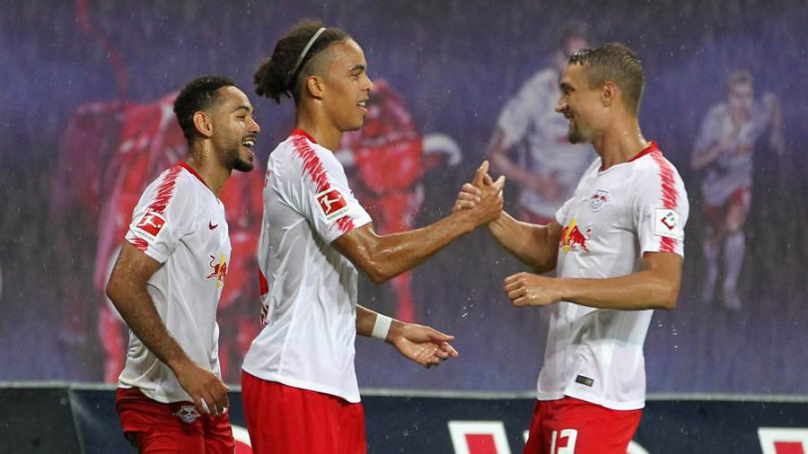 LEIPZIG, GERMANY - AUGUST 09:  Yussuf Poulsen celebrates the third goal with Stefan Ilsanker of Leipzig  during the UEFA Europa League Third Qualifying Round: 1st leg between RB Leipzig and Universitatea Craiova at Red Bull Arena on August 09, 2018 in Leipzig, Germany. (Photo by Karina Hessland-Wissel/Bongarts/Getty Images)