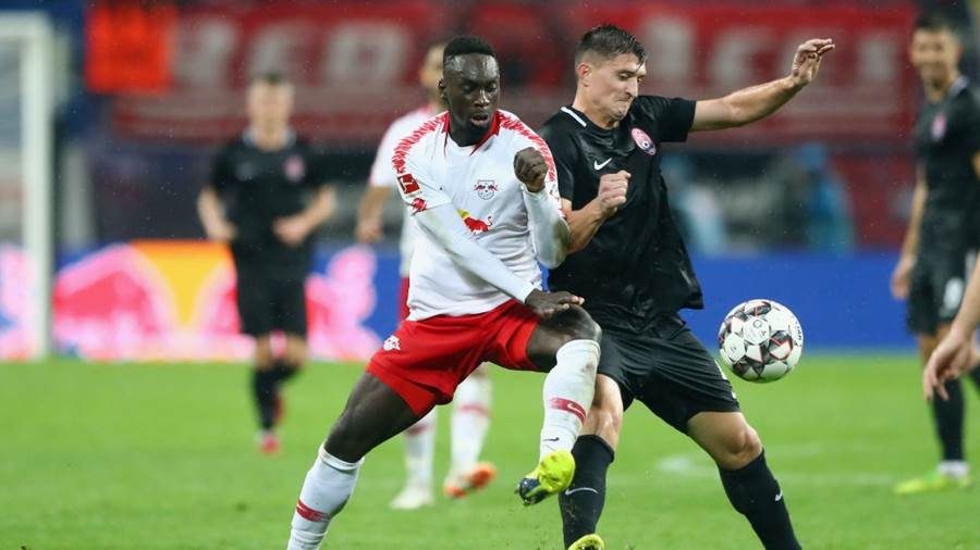 LEIPZIG, GERMANY - AUGUST 30: Jean-Kevin Augustin of Leipzig is challenged by Vasyl Priyna of Zorya during the UEFA Europa League Qualifying Play-Off second leg match between RB Leipzig and Zorya Luhansk at Red Bull Arena on August 30, 2018 in Leipzig, Germany.  (Photo by Martin Rose/Bongarts/Getty Images)