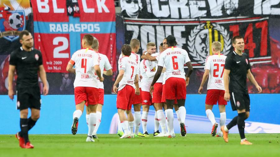 LEIPZIG, GERMANY - AUGUST 30: Matheus Cunha (covered) of Leipzig celebrates her team's first goal with team mates during the UEFA Europa League Qualifying Play-Off second leg match between RB Leipzig and Zorya Luhansk at Red Bull Arena on August 30, 2018 in Leipzig, Germany.  (Photo by Martin Rose/Bongarts/Getty Images
