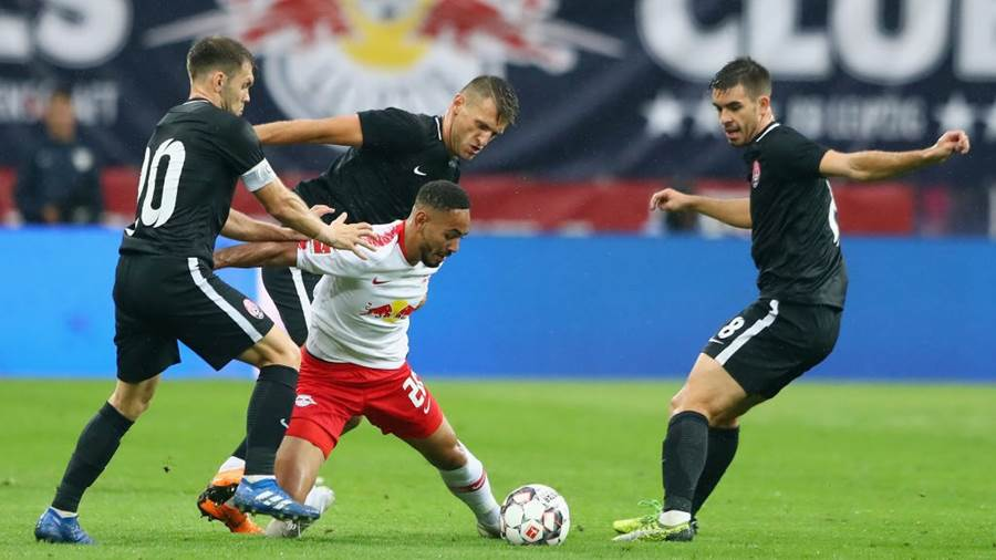 LEIPZIG, GERMANY - AUGUST 30:  Matheus Cunha of Leipzig is challenged by Oleksandr Karavaev of Zorya during the UEFA Europa League Qualifying Play-Off second leg match between RB Leipzig and Zorya Luhansk at Red Bull Arena on August 30, 2018 in Leipzig, Germany.  (Photo by Martin Rose/Bongarts/Getty Images)