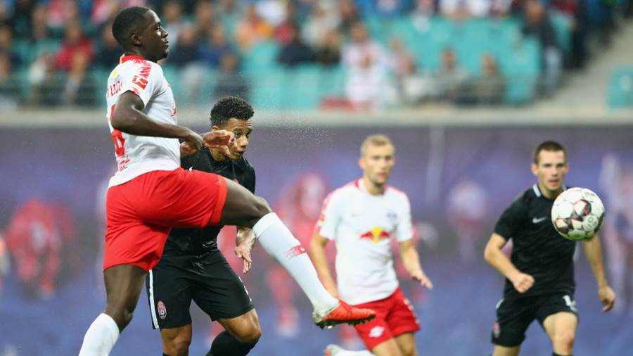 LEIPZIG, GERMANY - AUGUST 30: Rafael Ratao of Zorya scores his team's first goal under pressure from Ibrahima Konate of Leipzig during the UEFA Europa League Qualifying Play-Off second leg match between RB Leipzig and Zorya Luhansk at Red Bull Arena on August 30, 2018 in Leipzig, Germany.  (Photo by Martin Rose/Bongarts/Getty Images)