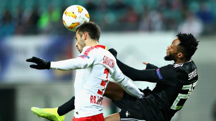 LEIPZIG, GERMANY - DECEMBER 13: Marcelo Saracchi of RB Leipzig heads the ball clear as Samuel Adegbenro of Rosenborg jumps for the ball during the UEFA Europa League Group B match between RB Leipzig and Rosenborg at Red Bull Arena on December 13, 2018 in Leipzig, Germany.  (Photo by Martin Rose/Bongarts/Getty Images)