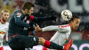 LEIPZIG, GERMANY - DECEMBER 16: Yussuf Poulsen of RB Leipzig is challenged by Stefan Bell of Mainz 05 during the Bundesliga match between RB Leipzig and 1. FSV Mainz 05 at Red Bull Arena on December 16, 2018 in Leipzig, Germany. (Photo by Boris Streubel/Bongarts/Getty Images)