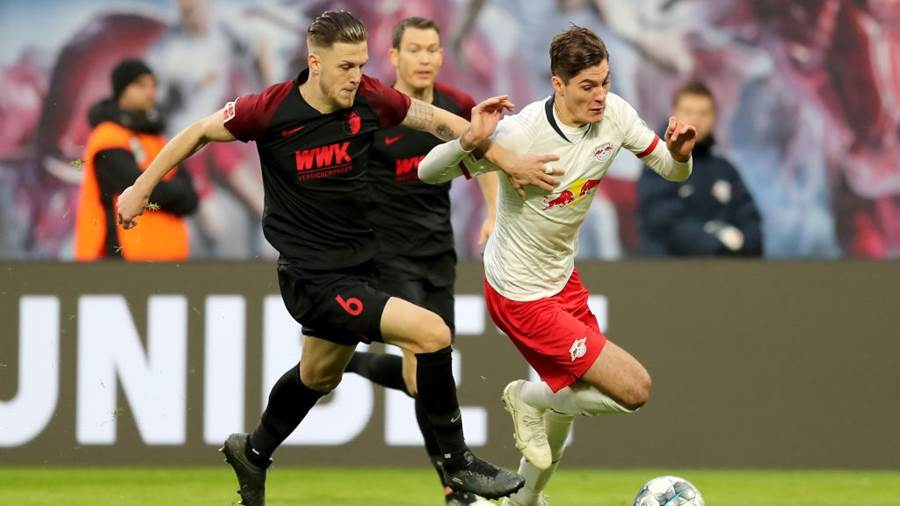 LEIPZIG, GERMANY - DECEMBER 21: Patrik Schick of RB Leipzig battles for possession with Jeffrey Gouweleeuw of FC Augsburg  during the Bundesliga match between RB Leipzig and FC Augsburg at Red Bull Arena on December 21, 2019 in Leipzig, Germany. (Photo by Boris Streubel/Bongarts/Getty Images)