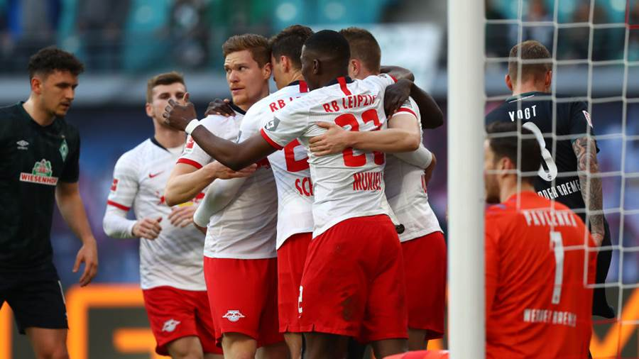 LEIPZIG, GERMANY - FEBRUARY 15: Lukas Klostermann of RB Leipzig celebrates with his team mates after scoring his team's first goal during the Bundesliga match between RB Leipzig and SV Werder Bremen at Red Bull Arena on February 15 2020 in Leipzig, Germany. (Photo by Martin Rose/Bongarts/Getty Images)
