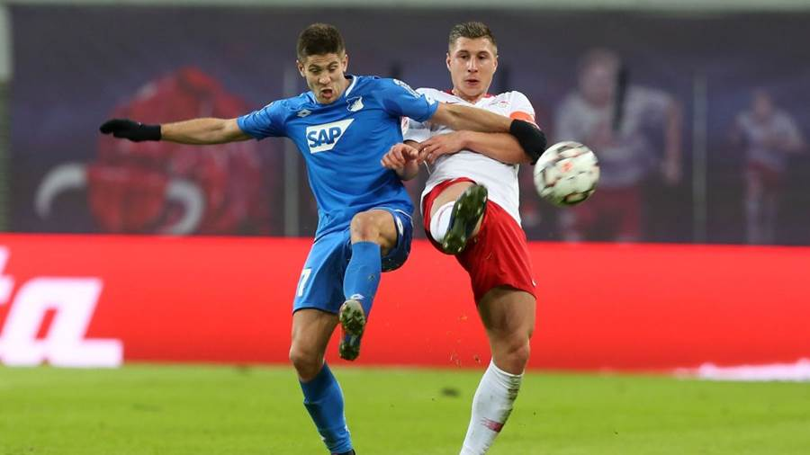 LEIPZIG, GERMANY - FEBRUARY 25:  Willi Orban (R) of Leipzig challenges for the ball Andrej Kramaric of Hoffenheim during the Bundesliga match between RB Leipzig and TSG 1899 Hoffenheim at Red Bull Arena on February 25, 2019 in Leipzig, Germany.  (Photo by Matthias Kern/Bongarts/Getty Images)