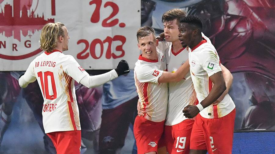 LEIPZIG, GERMANY - FEBRUARY 27: Alexander Sorloth of RB Leipzig celebrates their side's third goal with team mates Nordi Mukiele, Emil Forsberg and Dani Olmo during the Bundesliga match between RB Leipzig and Borussia Moenchengladbach at Red Bull Arena on February 27, 2021 in Leipzig, Germany. Sporting stadiums around Germany remain under strict restrictions due to the Coronavirus Pandemic as Government social distancing laws prohibit fans inside venues resulting in games being played behind closed doors. (Photo by Stuart Franklin/Getty Images)