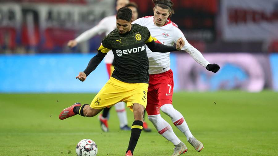 LEIPZIG, GERMANY - JANUARY 19:  Achraf Hakimi of Borussia Dortmund is challenged by Marcel Sabitzer of RB Leipzig during the Bundesliga match between RB Leipzig and Borussia Dortmund at Red Bull Arena on January 19, 2019 in Leipzig, Germany.  (Photo by Adam Pretty/Bongarts/Getty Images)