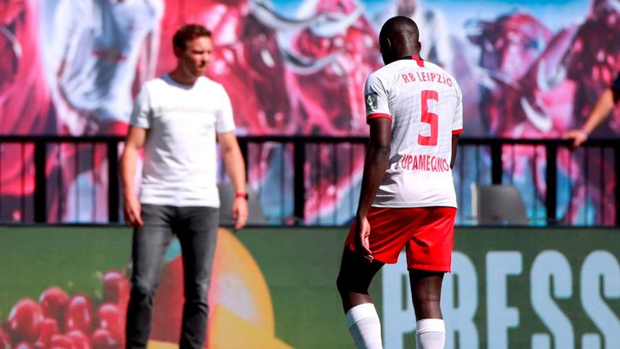 LEIPZIG, GERMANY - JUNE 06: Dayot Upamecano of RB Leipzig leaves the field after being shown a red card by referee Deniz Aytekin during the Bundesliga match between RB Leipzig and SC Paderborn 07 at Red Bull Arena on June 6, 2020 in Leipzig, Germany. (Photo by Hannibal Hanschke/Pool via Getty Images)