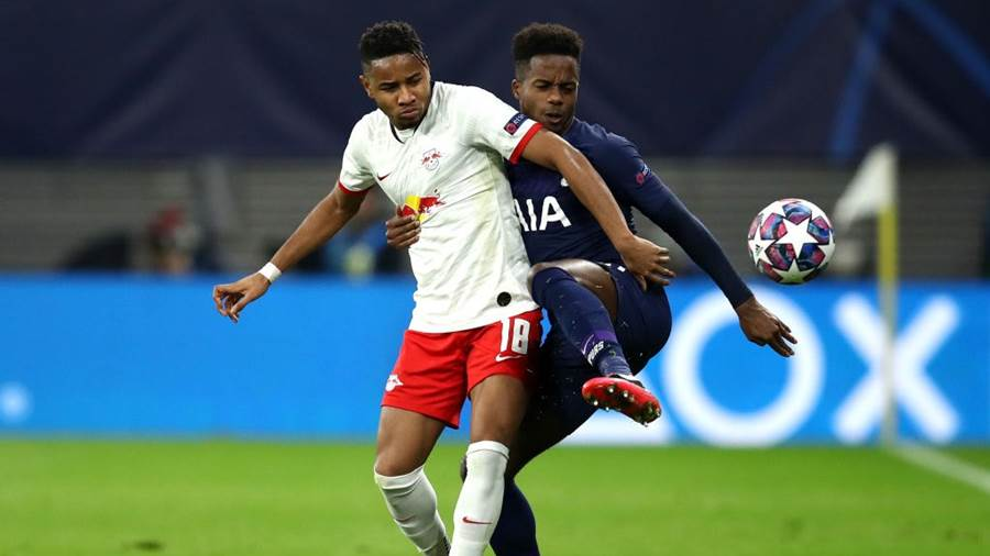 LEIPZIG, GERMANY - MARCH 10: Christopher Nkunku of RB Leipzig battles for possession with Ryan Sessegnon of Tottenham Hotspur  during the UEFA Champions League round of 16 second leg match between RB Leipzig and Tottenham Hotspur at Red Bull Arena on March 10, 2020 in Leipzig, Germany. (Photo by Maja Hitij/Bongarts/Getty Images)