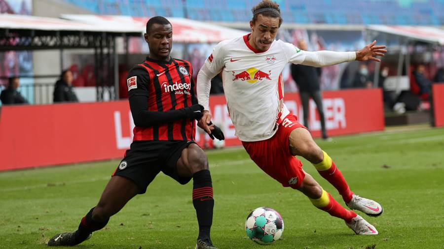 LEIPZIG, GERMANY - MARCH 14: Evan Ndicka of Eintracht Frankfurt battles for possession with Yussuf Poulsen of RB Leipzig during the Bundesliga match between RB Leipzig and Eintracht Frankfurt at Red Bull Arena on March 14, 2021 in Leipzig, Germany. Sporting stadiums around Germany remain under strict restrictions due to the Coronavirus Pandemic as Government social distancing laws prohibit fans inside venues resulting in games being played behind closed doors. (Photo by Boris Streubel/Getty Images)