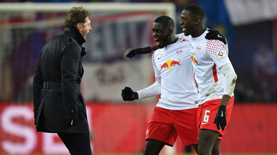 LEIPZIG, GERMANY - MARCH 18:  Ralph HasenhŸttl, head coach of Leipzig celebrates with Ibrahima KonatŽ and Dayot Upamecano after the Bundesliga match between RB Leipzig and FC Bayern Muenchen at Red Bull Arena on March 18, 2018 in Leipzig, Germany.  (Photo by Stuart Franklin/Bongarts/Getty Images)