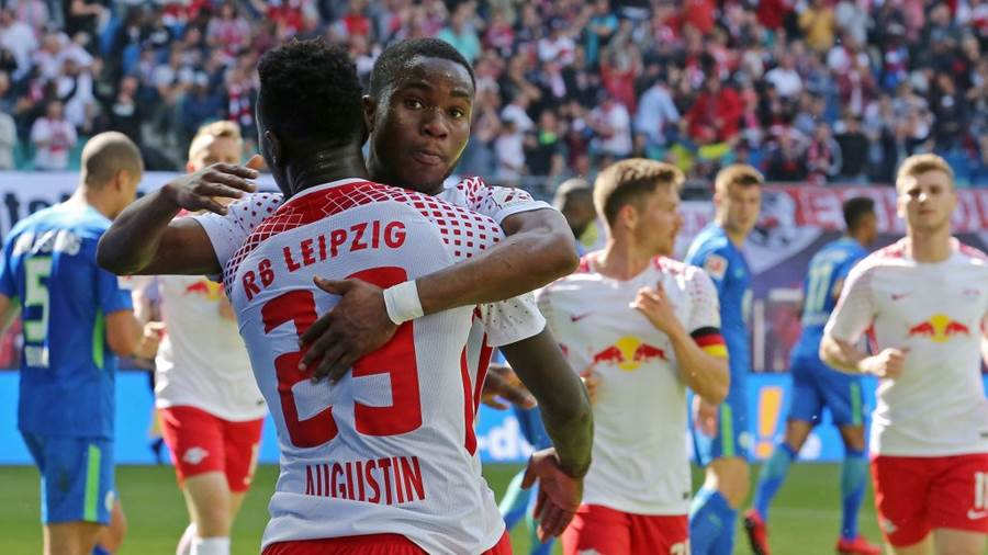 LEIPZIG, GERMANY - MAY 05:  Ademola Lookman (R) of Leipzig jubilates with team mate Jean Kevin Augustin after scoring the first goal during the Bundesliga match between RB Leipzig and VfL Wolfsburg at Red Bull Arena on May 5, 2018 in Leipzig, Germany.  (Photo by Matthias Kern/Bongarts/Getty Images)
