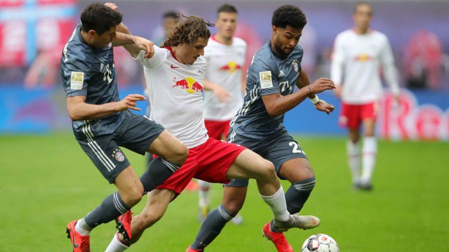 LEIPZIG, GERMANY - MAY 11:  Marcel Sabitzer of RB Leipzig is challenged by Serge Gnabry and Robert Lewandowski of Bayern Munich during the Bundesliga match between RB Leipzig and FC Bayern Muenchen at Red Bull Arena on May 11, 2019 in Leipzig, Germany (Photo by Alexander Hassenstein/Bongarts/Getty Images)