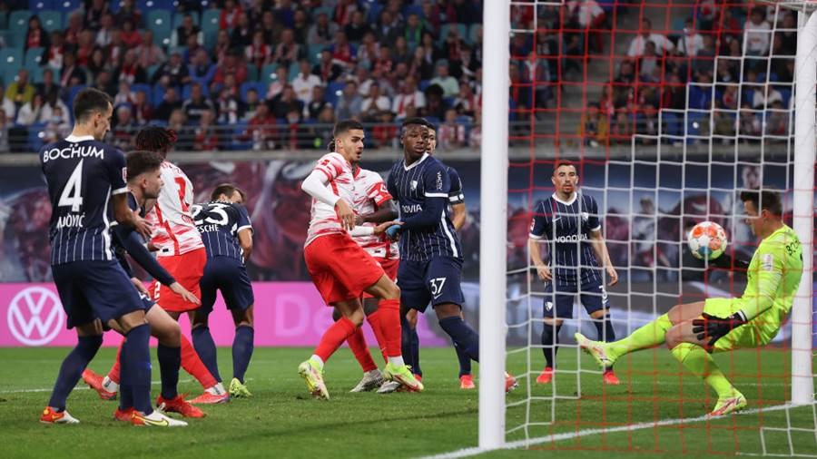 LEIPZIG, GERMANY - OCTOBER 02: André Silva of Leipzig  scores his team's first goal during the Bundesliga match between RB Leipzig and VfL Bochum at Red Bull Arena on October 02, 2021 in Leipzig, Germany. (Photo by Alex Grimm/Getty Images)