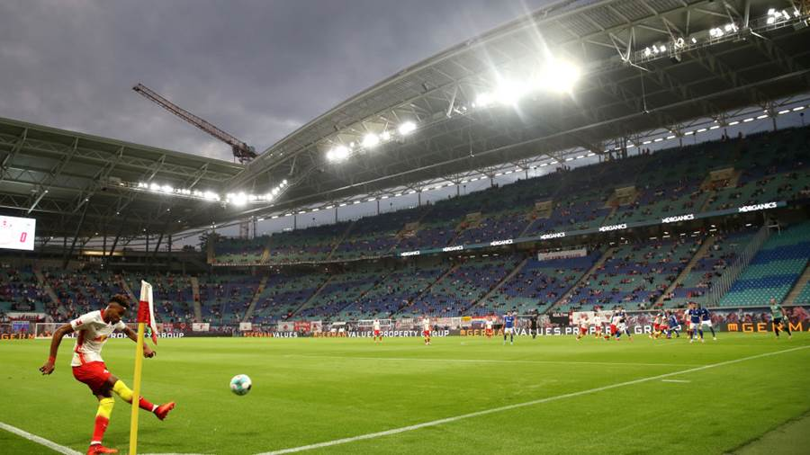 LEIPZIG, GERMANY - OCTOBER 03: General view inside the stadium as Christopher Nkunku of RB Leipzig takes a corner kick during the Bundesliga match between RB Leipzig and FC Schalke 04 at Red Bull Arena on October 03, 2020 in Leipzig, Germany. 8,500 fans have been allowed in to the stadium as COVID-19 precautions ease in Germany. (Photo by Alexander Hassenstein/Getty Images)