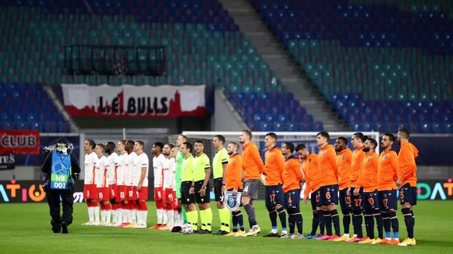 LEIPZIG, GERMANY - OCTOBER 20: Players line up prior to the UEFA Champions League Group H stage match between RB Leipzig and İstanbul Basaksehir at Red Bull Arena on October 20, 2020 in Leipzig, Germany. A limited number of spectators (900) will be in attendance as Covid-19 pandemic restrictions are eased in Germany. (Photo by Maja Hitij/Getty Images)