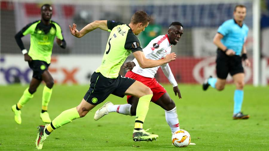 LEIPZIG, GERMANY - OCTOBER 25:  Jozo Simunovic of Celtic battles for possession with Jean-Kevin Augustin of RB Leipzig during the UEFA Europa League Group B match between RB Leipzig and Celtic at Red Bull Arena on October 25, 2018 in Leipzig, Germany.  (Photo by Martin Rose/Bongarts/Getty Images)