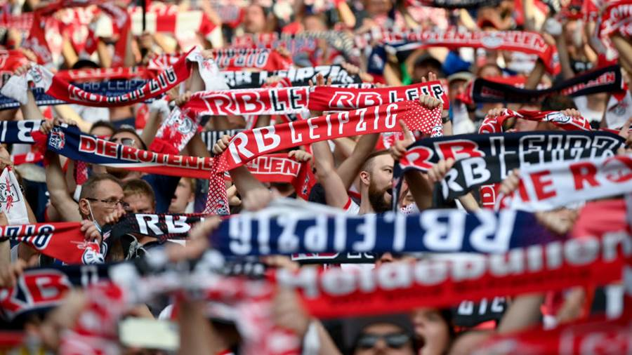 LEIPZIG, GERMANY - SEPTEMBER 11: Supporters of Leipzig cheer their team prior to the Bundesliga match between RB Leipzig and FC Bayern München at Red Bull Arena on September 11, 2021 in Leipzig, Germany. (Photo by Matthias Hangst/Getty Images)