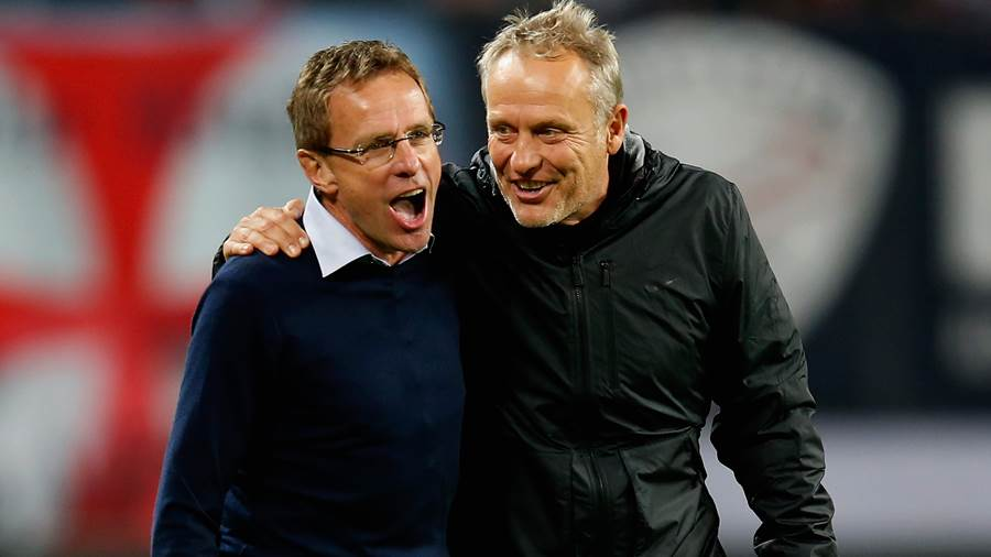 LEIPZIG, GERMANY - SEPTEMBER 24:  Christian Streich (R), head coach of Freiburg hugs Ralf Rangnick, head coach of Leipzig after the Second Bundesliga match between RB Leipzig and SC Freiburg at Red Bull Arena on September 24, 2015 in Leipzig, Germany.  (Photo by Boris Streubel/Bongarts/Getty Images)