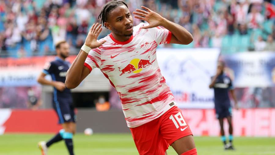 LEIPZIG, GERMANY - SEPTEMBER 25: Christopher Nkunku of RB Leipzig celebrates scoring his sides first goal during the Bundesliga match between RB Leipzig and Hertha BSC at Red Bull Arena on September 25, 2021 in Leipzig, Germany. (Photo by Alexander Hassenstein/Getty Images)