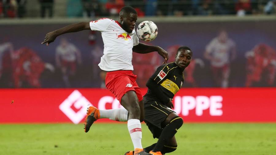 LEIPZIG, GERMANY - SEPTEMBER 26:  Dayot Upamecano (L) of Leipzig battles for the ball with Chadrac Akolo of Stuttgart during the Bundesliga match between RB Leipzig and VfB Stuttgart at Red Bull Arena on September 26, 2018 in Leipzig, Germany.  (Photo by Matthias Kern/Bongarts/Getty Images)