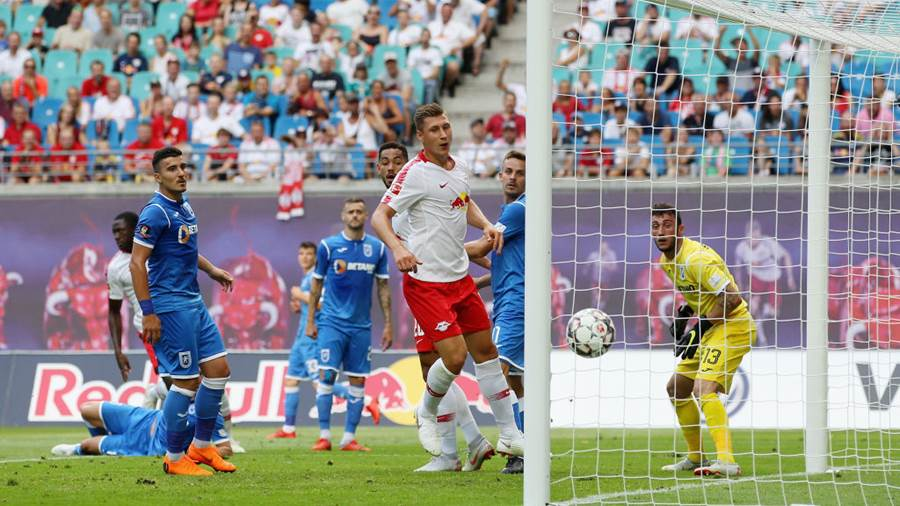 LEIPZIG, SAXONY - AUGUST 09:  Ibrahima Konate of Leipzig scores the opening goal, Goalkeeper Mirko Pigliacelli of Craiova without a chance during the UEFA Europa League Third Qualifying Round: 1st leg between RB Leipzig and Universitatea Craiova at Red Bull Arena on August 09, 2018 in Leipzig, Germany.  (Photo by Karina Hessland/Bongarts/Getty Images)