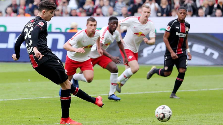 LEVERKUSEN, GERMANY - APRIL 06: Kai Havertz of Bayer 04 Leverkusen scores his team's first goal from the penalty spot during the Bundesliga match between Bayer 04 Leverkusen and RB Leipzig at BayArena on April 06, 2019 in Leverkusen, Germany. (Photo by Christof Koepsel/Bongarts/Getty Images)