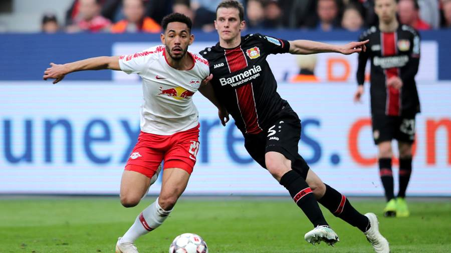 LEVERKUSEN, GERMANY - APRIL 06: Matheus Cunha of RB Leipzig is challenged by Sven Bender of Bayer 04 Leverkusen during the Bundesliga match between Bayer 04 Leverkusen and RB Leipzig at BayArena on April 06, 2019 in Leverkusen, Germany (Photo by Christof Koepsel/Bongarts/Getty Images)