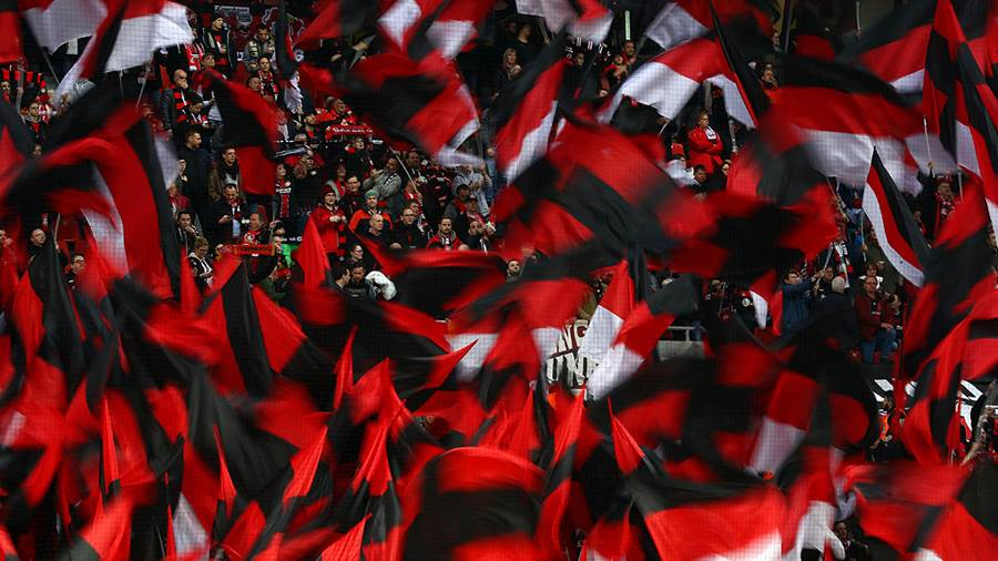 LEVERKUSEN, GERMANY - FEBRUARY 17: Fans wave flags during the Bundesliga match between Bayer 04 Leverkusen and Fortuna Duesseldorf at BayArena on February 17, 2019 in Leverkusen, Germany. (Photo by Maja Hitij/Bongarts/Getty Images)