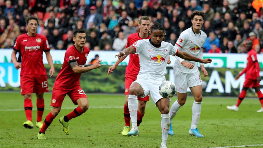 LEVERKUSEN, GERMANY - OCTOBER 05: Christopher Nkunku of Leipzig scores the first goal during the Bundesliga match between Bayer 04 Leverkusen and RB Leipzig at BayArena on October 05, 2019 in Leverkusen, Germany (Photo by Christof Koepsel/Bongarts/Getty Images)