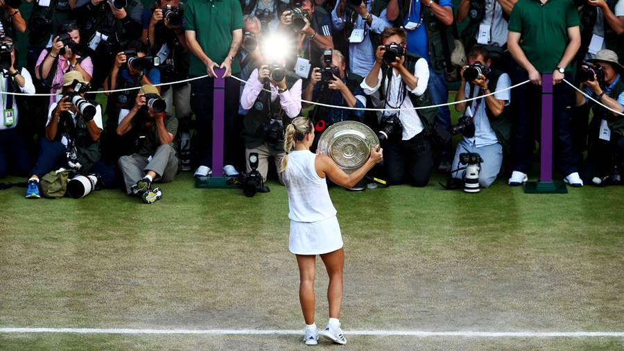 LONDON, ENGLAND - JULY 14:  Angelique Kerber of Germany holds the Venus Rosewater Dish as she poses for photographs after defeating Serena Williams of The United States in the Ladies' Singles final on day twelve of the Wimbledon Lawn Tennis Championships at All England Lawn Tennis and Croquet Club on July 14, 2018 in London, England.  (Photo by Clive Brunskill/Getty Images)