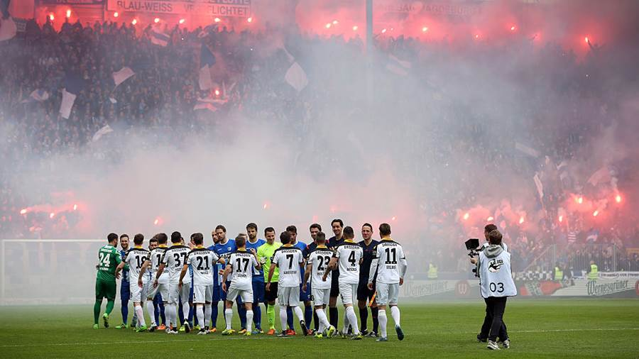MAGDEBURG, GERMANY - APRIL 16:  Supporters of Magdeburg with pyrotechnics prior to the Third League match between 1. FC Magdeburg and Dynamo Dresden at MDCC-Arena on April 16, 2016 in Magdeburg, Germany.  (Photo by Ronny Hartmann/Bongarts/Getty Images)