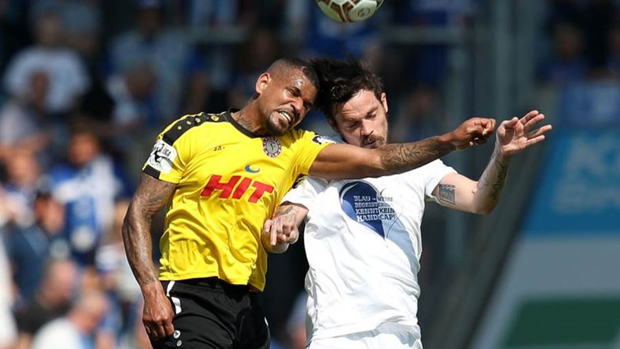 MAGDEBURG, GERMANY - APRIL 21: Daniel Keita-Ruel (L) of Fortuna Koeln and Dennis Erdmann (R) of 1. FC Magdeburg head for the ball during the 3. Liga match between 1. FC Magdeburg and SC Fortuna Koeln at MDCC-Arena on April 21, 2018 in Magdeburg, Germany. (Photo by Ronny Hartmann/Bongarts/Getty Images)
