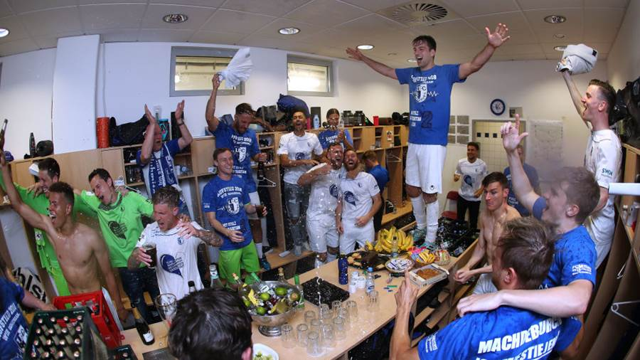 MAGDEBURG, GERMANY - APRIL 21:  (EDITORS NOTE: This image was shot with a fisheye lens.) Players of 1. FC Magdeburg celebrate their promotion to Second Bundesliga after the 3. Liga match between 1. FC Magdeburg and SC Fortuna Koeln at MDCC-Arena on April 21, 2018 in Magdeburg, Germany. (Photo by Ronny Hartmann/Bongarts/Getty Images)