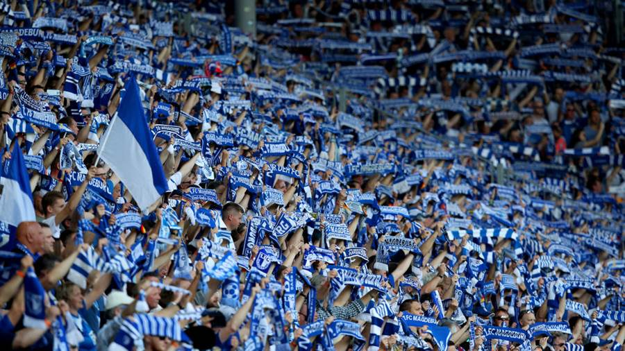 MAGDEBURG, GERMANY - APRIL 21: Supporters of 1. FC Magdeburg ahead to the 3. Liga match between 1. FC Magdeburg and SC Fortuna Koeln at MDCC-Arena on April 21, 2018 in Magdeburg, Germany. (Photo by Ronny Hartmann/Bongarts/Getty Images)