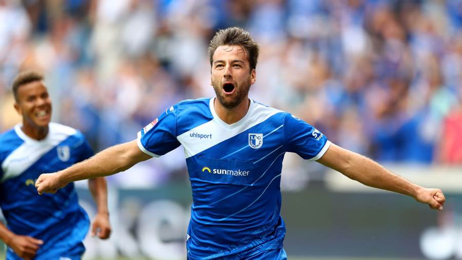 MAGDEBURG, GERMANY - AUGUST 05:  Christian Beck  of Magdeburg celebrates after he scores the opening goal during the Second Bundesliga match between 1. FC Magdeburg and FC St. Pauli at MDCC Arena on August 5, 2018 in Magdeburg, Germany.  (Photo by Martin Rose/Bongarts/Getty Images)