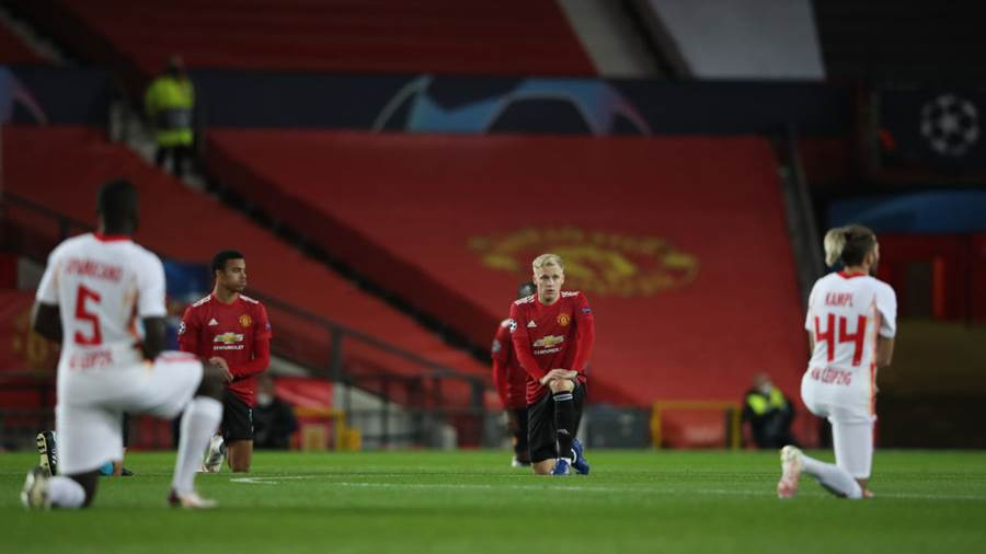 MANCHESTER, ENGLAND - OCTOBER 28: Donny Van De Beek of Manchester United takes a knee in support of the Black Lives Matter movement prior to the UEFA Champions League Group H stage match between Manchester United and RB Leipzig at Old Trafford on October 28, 2020 in Manchester, England. Sporting stadiums around the UK remain under strict restrictions due to the Coronavirus Pandemic as Government social distancing laws prohibit fans inside venues resulting in games being played behind closed doors. (Photo by Clive Brunskill/Getty Images)