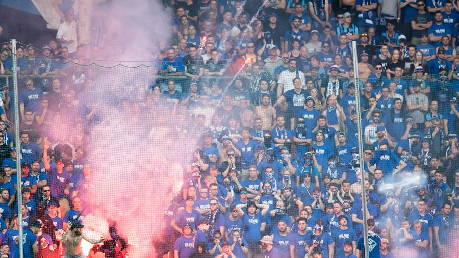 MANNHEIM, GERMANY - MAY 27: Supporters of Mannheim light fireworks during the Third League Playoff Leg 2 match between SV Waldhof Mannheim and KFC Uerdingen at Carl-Benz-Stadium on May 27, 2018 in Mannheim, Germany. (Photo by Simon Hofmann/Bongarts/Getty Images)