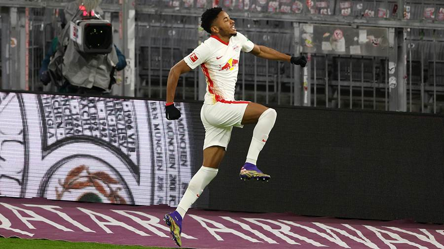 MUNICH, GERMANY - DECEMBER 05: Christopher Nkunku of RB Leipzig celebrates after scoring his team's first goal during the Bundesliga match between FC Bayern Muenchen and RB Leipzig at Allianz Arena on December 05, 2020 in Munich, Germany. Football Stadiums around Germany remain empty due to the Coronavirus Pandemic as Government social distancing laws prohibit fans inside venues resulting in fixtures being played behind closed doors. (Photo by Alexander Hassenstein/Getty Images)