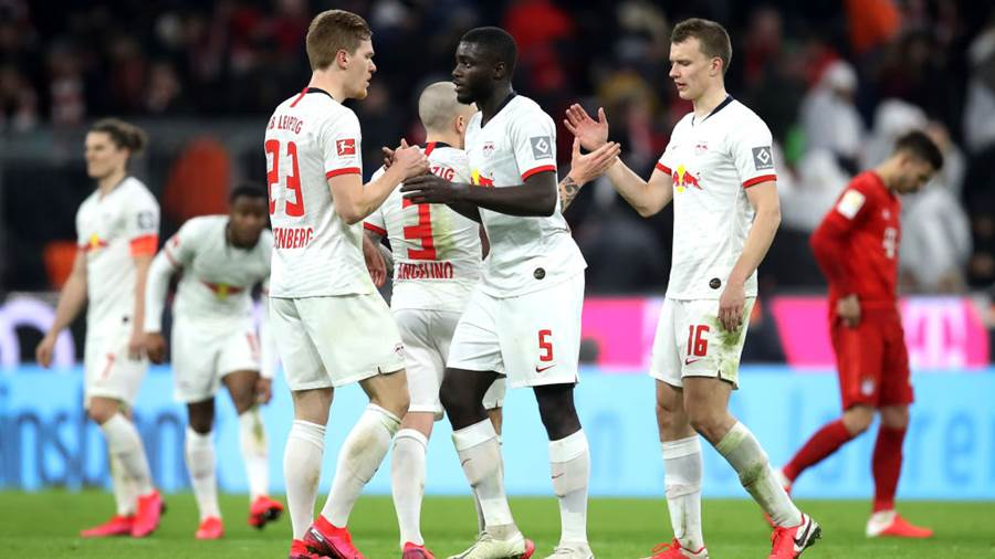 MUNICH, GERMANY - FEBRUARY 09: Marcel Halstenberg of RB Leipzig shakes hands with Dayot Upamecano of RB Leipzig after the Bundesliga match between FC Bayern Muenchen and RB Leipzig at Allianz Arena on February 09, 2020 in Munich, Germany. (Photo by Alex Grimm/Bongarts/Getty Images)