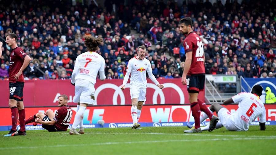 NUREMBERG, GERMANY - MARCH 02: Lukas Klostermann of RB Leipzig celebrates after scoring his team's first goal with his team mates during the Bundesliga match between 1. FC Nuernberg and RB Leipzig at Max-Morlock-Stadion o March 02, 2019 in Nuremberg, Germany. (Photo by Sebastian Widmann/Bongarts/Getty Images)