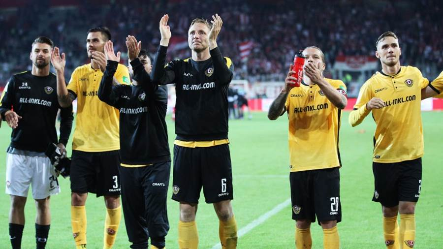REGENSBURG, GERMANY - SEPTEMBER 14:  Aias Aosman, Marco Hartmann and Patrick Ebert of Dynamo Dresden celebrate after victory in the Second Bundesliga match between SSV Jahn Regensburg and SG Dynamo Dresden at Continental Arena on September 14, 2018 in Regensburg, Germany.  (Photo by Adam Pretty/Bongarts/Getty Images)