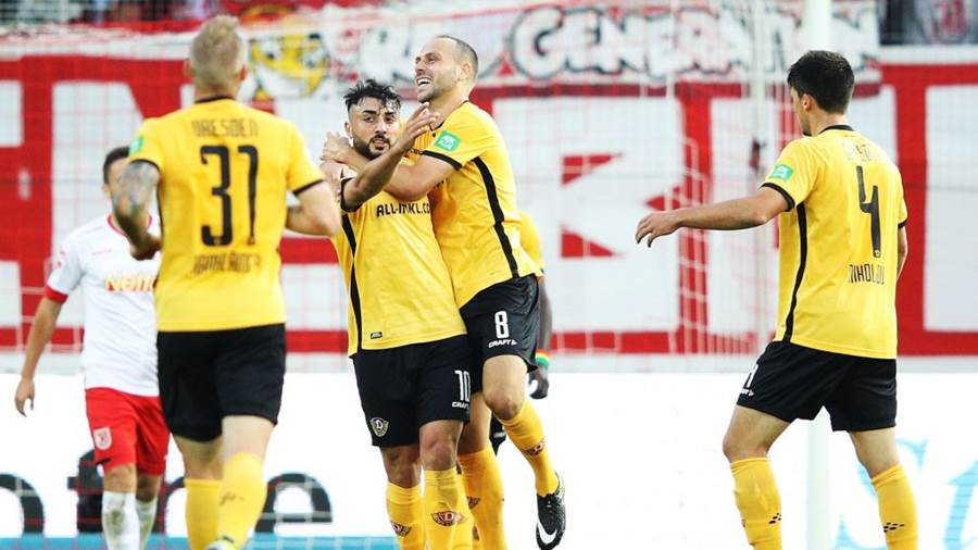 REGENSBURG, GERMANY - SEPTEMBER 14:  Aias Aosman of Dynamo Dresden is congratulated by Rico Benatelli of Dynamo Dresden after scoring the first goal during the Second Bundesliga match between SSV Jahn Regensburg and SG Dynamo Dresden at Continental Arena on September 14, 2018 in Regensburg, Germany.  (Photo by Adam Pretty/Bongarts/Getty Images)