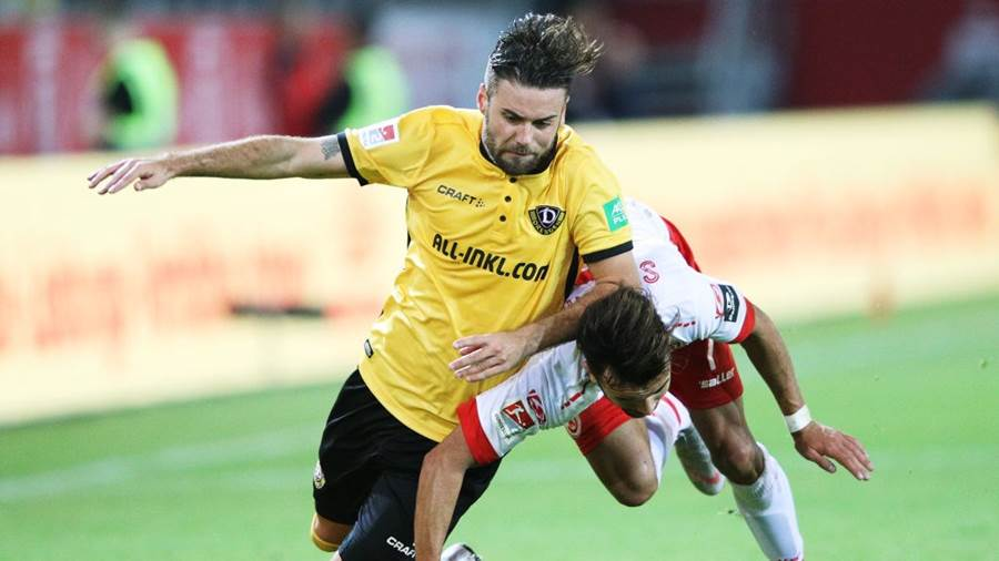 REGENSBURG, GERMANY - SEPTEMBER 14:  Albion Vrenezi of Jahn Regensburg challenges Niklas Kreuzer of Dynamo Dresden during the Second Bundesliga match between SSV Jahn Regensburg and SG Dynamo Dresden at Continental Arena on September 14, 2018 in Regensburg, Germany.  (Photo by Adam Pretty/Bongarts/Getty Images)