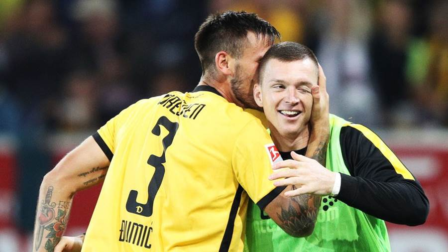 REGENSBURG, GERMANY - SEPTEMBER 14:  Dario Dumic of Dynamo Dresden celebrates scoring the second goal with a kiss for Haris Duljevic of Dynamo Dresden during the Second Bundesliga match between SSV Jahn Regensburg and SG Dynamo Dresden at Continental Arena on September 14, 2018 in Regensburg, Germany.  (Photo by Adam Pretty/Bongarts/Getty Images)