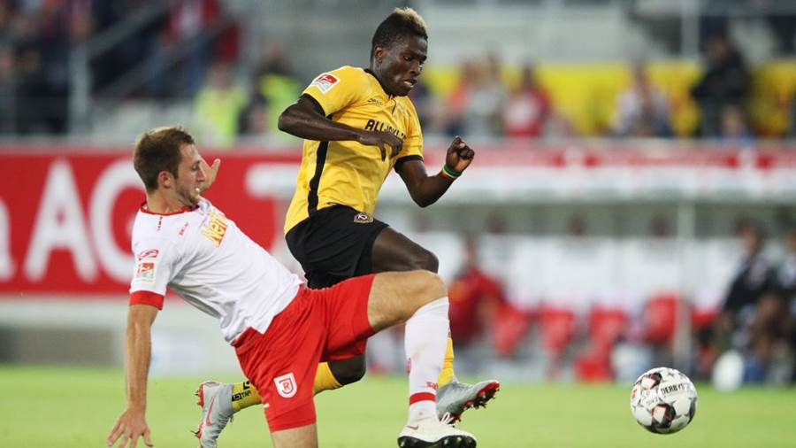 REGENSBURG, GERMANY - SEPTEMBER 14:  Moussa Kone of Dynamo Dresden is challenged by Andreas Geipl of Jahn Regensburg during the Second Bundesliga match between SSV Jahn Regensburg and SG Dynamo Dresden at Continental Arena on September 14, 2018 in Regensburg, Germany.  (Photo by Adam Pretty/Bongarts/Getty Images)