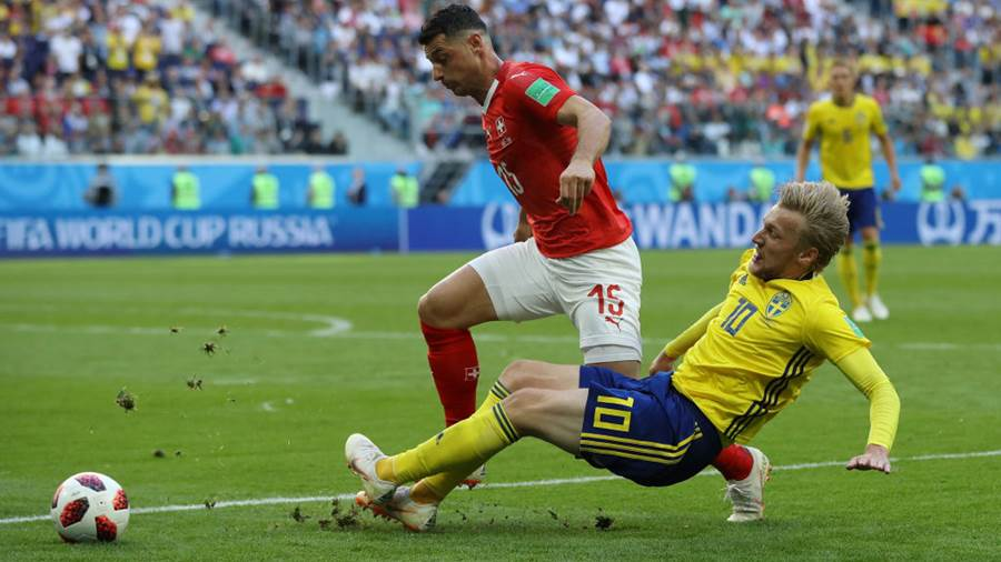 SAINT PETERSBURG, RUSSIA - JULY 03:  Emil Forsberg of Sweden tackles Blerim Dzemaili of Switzerland during the 2018 FIFA World Cup Russia Round of 16 match between Sweden and Switzerland at Saint Petersburg Stadium on July 3, 2018 in Saint Petersburg, Russia.  (Photo by Francois Nel/Getty Images)